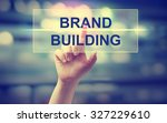hand pressing brand building on ... | Shutterstock . vector #327229610