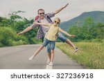 father and daughter walking on... | Shutterstock . vector #327236918