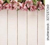 Alstroemeria Flowers On Wooden...