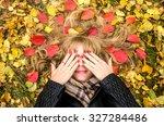 Girl Lying On The Autumn Leaves
