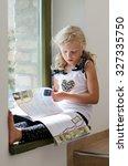 adorable scholar blond girl... | Shutterstock . vector #327335750