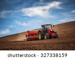 farmer in tractor preparing... | Shutterstock . vector #327338159