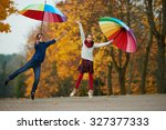 boy and girl among the leaves... | Shutterstock . vector #327377333