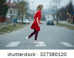 Small photo of photo of girl crossing street on the crosswalk