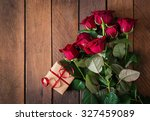 Stock photo bouquet of red roses on a dark wooden background top view 327459089