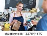 waitress serving customer at... | Shutterstock . vector #327544670