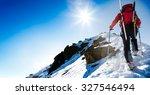 mountaineer walking up along a... | Shutterstock . vector #327546494