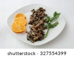 dish of fried mushrooms with... | Shutterstock . vector #327554399