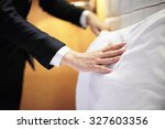 Stock photo hands making bed from hotel room service 327603356