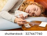 sick woman laying in bed under... | Shutterstock . vector #327667760