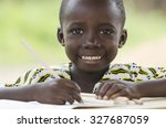Stock photo writing little black african ethnicity boy handsome young african man close up shot beautiful 327687059