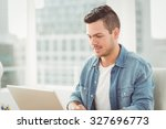 smiling young man working on... | Shutterstock . vector #327696773