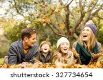 smiling young family throwing... | Shutterstock . vector #327734654