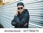 A Young Man In A Stylish Winte...