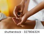 spa massage. aromatherapy oil... | Shutterstock . vector #327806324