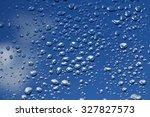 rain drops on window with blue...