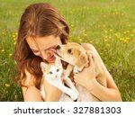 Stock photo a cute young puppy licking the face of a pretty young girl as she is laughing 327881303