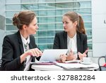 two young business women works... | Shutterstock . vector #327882284