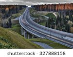 Speed track in Russia at sunset, crosses the autumn forest. - stock photo