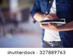 student using tablet computer... | Shutterstock . vector #327889763