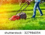 man in motion with lawnmower... | Shutterstock . vector #327986054