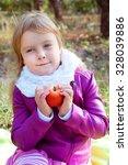 cute little blond kid holding... | Shutterstock . vector #328039886