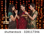 young women celebrating diwali | Shutterstock . vector #328117346