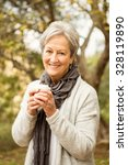 senior woman in the park on an... | Shutterstock . vector #328119890