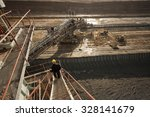 Coal mine field photographed with a wide angle lens from a top of huge drill machine. Bird perspective. - stock photo
