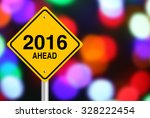Small photo of New Year 2016 Ahead road sign with beautiful bokeh background.