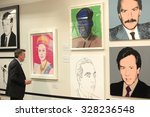 Small photo of VANCOUVER, CANADA - FEBRUARY 27, 2015: Visitors attend the biggest in Canada exhibition of works of pop art legend Andy Warhol in Yaletown warehouse in Vancouver, Canada, Feb.27, 2015.