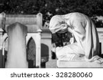 Statue Of Weeping Woman On A...