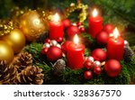 Small photo of Studio shot of a nice advent wreath with baubles and four burning red candles