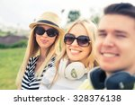 three young happy people... | Shutterstock . vector #328376138