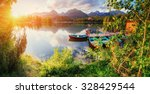 boat on the dock surrounded... | Shutterstock . vector #328429544