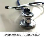 close up medical stethoscope on ... | Shutterstock . vector #328505360