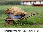 Wheelbarrow With Natural Cattl...