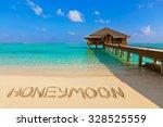 word honeymoon on beach  ... | Shutterstock . vector #328525559