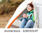 Camping Happy Woman Sitting...