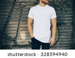 young man wearing white blank t ... | Shutterstock . vector #328594940