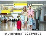 family with luggage at the... | Shutterstock . vector #328595573