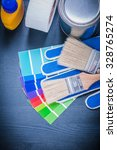 Small photo of Paint containers color sampler safety gloves paintbrushes household tape.