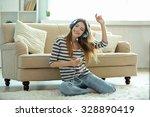 woman listening music in... | Shutterstock . vector #328890419