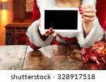 free space on tablet and woman...   Shutterstock . vector #328917518