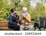 elder man and carer in the park | Shutterstock . vector #328923644