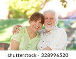 senior couple sitting on a park ... | Shutterstock . vector #328996520