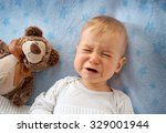 one year old baby crying in bed ... | Shutterstock . vector #329001944