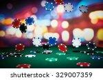 poker chips on table in casino   Shutterstock . vector #329007359