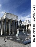 Small photo of Russian State Library (Library name of Lenin) and a monument of russian writer Dostoievsky, in Moscow