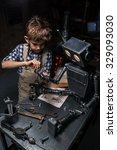 young boy mechanic repairing...   Shutterstock . vector #329093030
